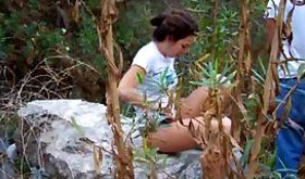 Whore lying on the huge rock while being penetrated