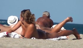 Amateur blonde with a great tan sunbathing naked