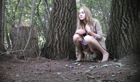 Leggy blonde in a sexy skirt decides to take a leak in the woods