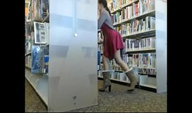Slutty girlfriend crawling half-naked among bookshelves