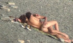 Leggy chick enjoys spooning sex on a nudist beach, in public