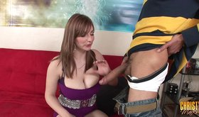 Christy Marks blows one of her biggest fans on a red couch