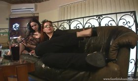 Great-looking femdom mistresses showing off their feet, all casual