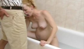 Pregnant blonde is masturbating and blowing junk in the bath