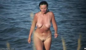 Natural tits nudist shows her body on a deserted nudist beach
