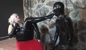 Blond-haired babe in latex has her slave worshiping those feet