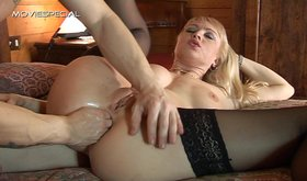 Open-minded blonde in back stockings is getting her anal fisted