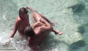 Gorgeous naked bitch and her handsome muscular guy on a beach