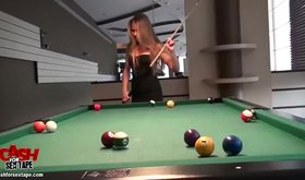 Smiley beauty wearing pretty dress starts playing pool