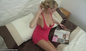 Dress-wearing blonde showcasing her beautiful breasts