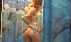 Trimmed pussy blonde shows that soapy body of hers in the shower